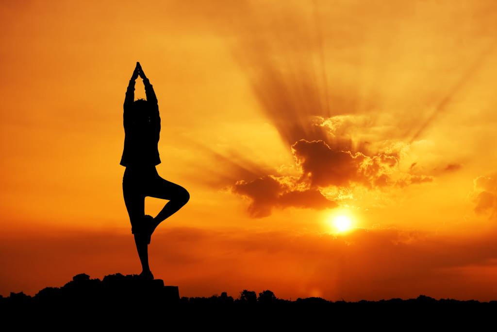 girl-yoga-sunset-tree-pose
